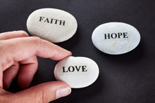 Woman Takes The Stone With The Word Love