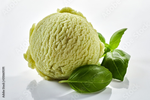 Herbal basil flavored ice cream with fresh leaves Fototapet