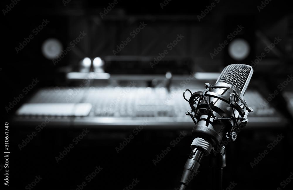 Fototapeta black and white condenser microphone in recording studio