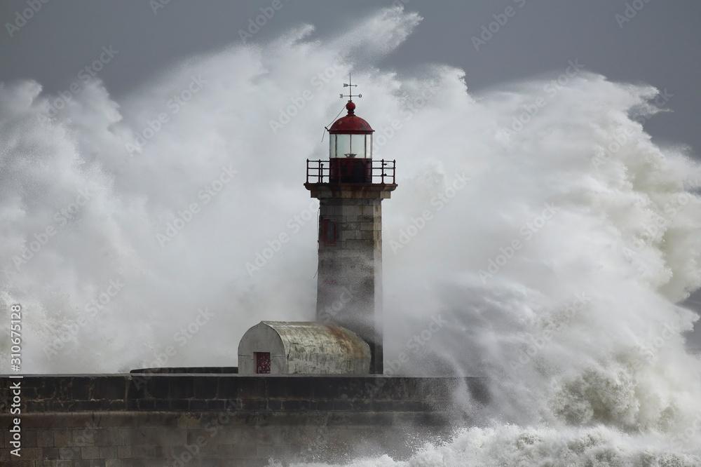 Fototapeta Stormy dramatic wave over lighthouse