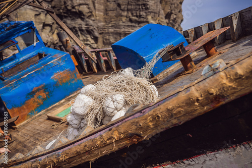 Photo Korean fishing boats washed ashore at Tobizin Cape, Russian Island, Vlaivostok