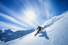 Skier Skiing On Mountain Slope