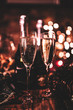 canvas print picture - New Year's Eve celebration with bottles and glasses of champagne. Masquerade themed party. Concept of celebration and luxury lifestyle.