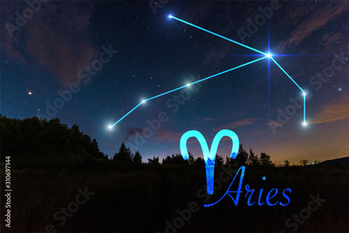 Photo dark landscape with night starry sky and Aries constellation