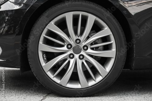 Cuadros en Lienzo Modern luxury car wheel on a light alloy disc,