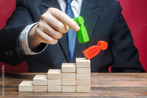 A businessman replaces an employee with a new one on career ladder. Head Offset. Business optimization. Fight corruption. System recovery. Strengthening change of power, capture control of business.