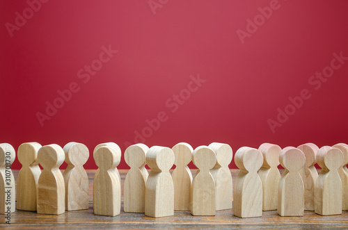 Fototapeta A crowd of wooden figures of people. Society, demography. Customers and buyers, statistics, preferences of Population. group of citizens, rally, political movement or electorate. Employees. Copy space obraz