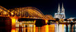 Cologne Cathedral and Hohenzollern Bridge at night/ twilight , Cologne, Germany