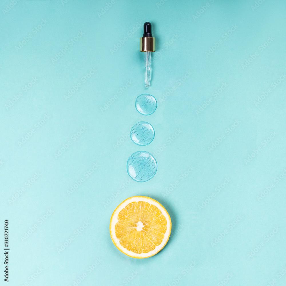 Fototapeta Medical dropper of hyaluron on a blue background Vitamin C medical concept