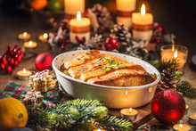 Christmas Dinner From Fish Salmon In Roasting Dish With Festive Decoration Advent Wreath And Candles.