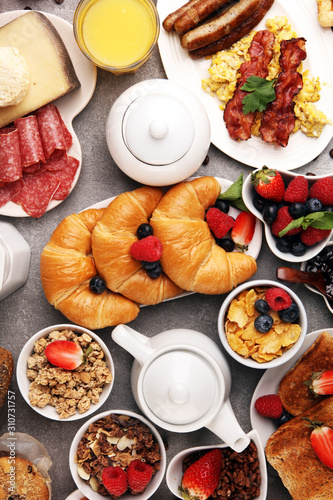 Breakfast served with coffee, orange juice, croissants, cereals and fruits. Balanced diet.  - 310731757