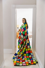 Beautiful Teen Girl Wrapped In Colorful Vintage Blanket