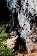 Climbers Training On Cliff Providing Insurance