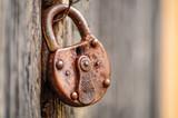 Old lock on wooden door.