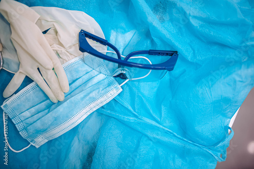 Fotografie, Obraz gloves mask, glasses and uniform of the surgeon after surgery.