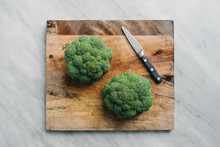 Broccoli Heads On A Cutting Board