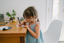 Little Girl Writes A Note