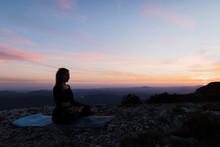 Woman Doing Yoga On Mountain Cliff
