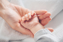 Close-up Baby Hand On Mother's...