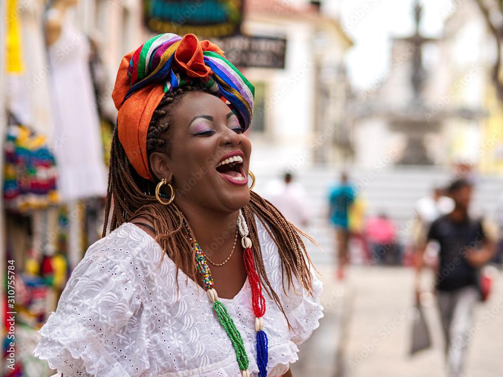 Fototapeta Salvador da Bahia, Brazil, Happy Brazilian Woman of African Descent Dressed in Traditional Baiana Costumes