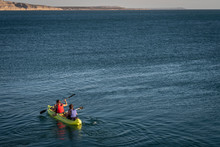 Two People Practicing Kayak On A Turquoise Blue Lake.Tierra Del Fuego, Argentina