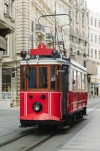 Retro Tram Driving On Street Between Vintage Buildings. Istiklal Street, Istambul.