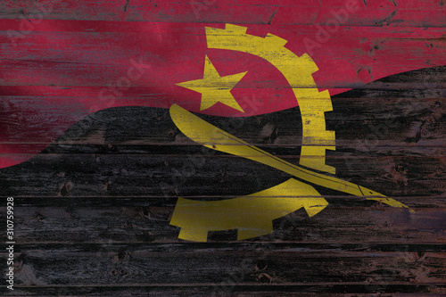Angola flag on an old wooden plank forming a background Canvas Print