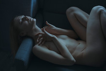 Undressed Girl Lies On A Chair...