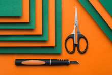 Scissors And Cutter On Green A...