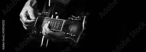 Guitarist hands and guitar close up Fotobehang