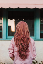 Back View Of Woman's Beautiful Pink Wig