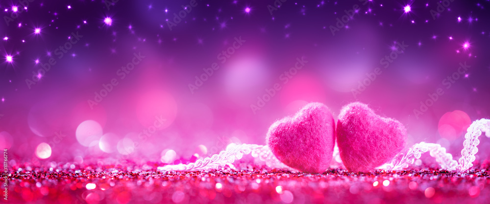 Fototapeta Two Soft Pink Hearts With Lace On Purple Glitter Background With Sparkles - Valentine's Day Concept