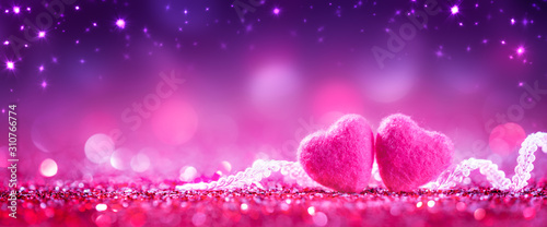 Fototapeta Two Soft Pink Hearts With Lace On Purple Glitter Background With Sparkles - Valentine's Day Concept obraz