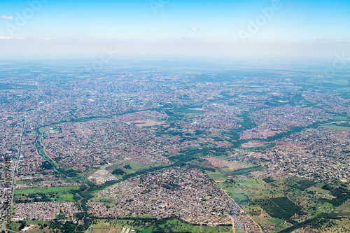 Top view of a city with low density constructions, few tall buildings Wallpaper Mural