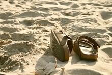 Birkenstocks On The Beach
