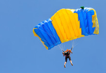 Skydiver Under Yellow And Blue...
