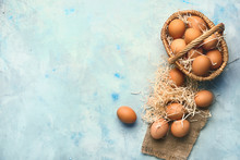 Basket With Fresh Eggs On Colo...