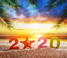 Number 2020 And Starfish On The Sand Beach. Happy New Year And  Summer Holiday Concept.