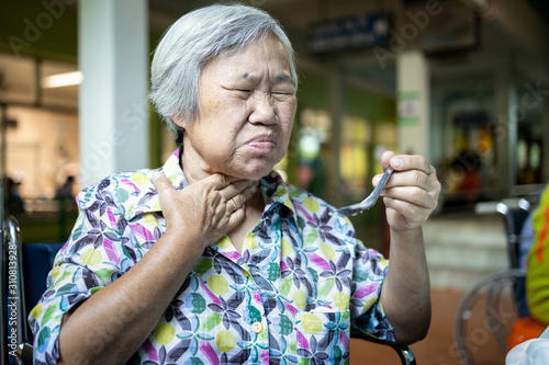 Asian senior woman suffers from choke,clogged up food,elderly people choking dur Wallpaper Mural