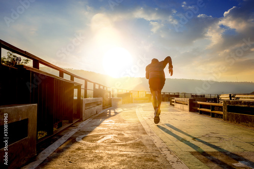 Papel de parede Silhouette of man running sprinting on walk way