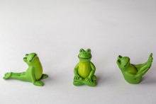 Frogs Doing Yoga On White Background