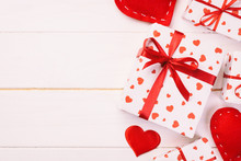 Valentine Or Other Holiday Handmade Present In Paper With Red Hearts And Gifts Box In Holiday Wrapper. Present Box Gift On White Wooden Table Top View With Copy Space, Empty Space For Design