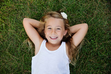 Smiling Young Girl Lying In Th...