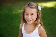 Laughing Blonde Little Girl In Backyard