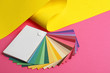 canvas print picture - Color palette and yellow paper on pink background
