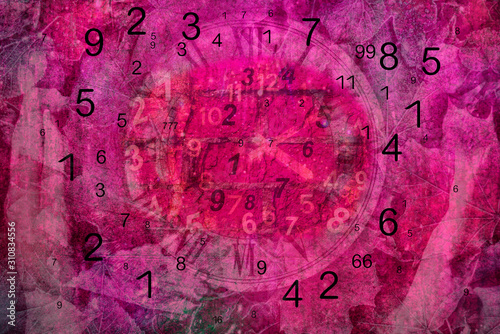 Photo  Black numbers on pink background, numerology