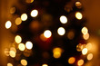 Lights of the christmas tree in the city in blur. Bokeh background concept. New year lights defocused.