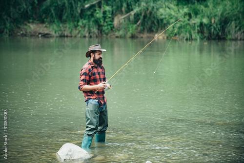 Photo Male fishing on the lake