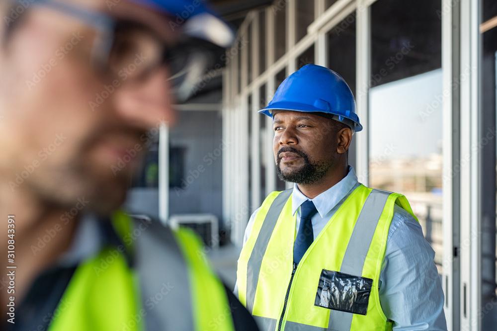 Fototapeta Foreman thinking at construction site