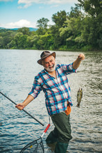Brutal Man Stand In River Water. Fishing As Holiday. Relax In Natural Environment. Successful Fly Fishing. Life Is Always Better When I Am Fishing. Trout Bait. Luxury Life Concept.